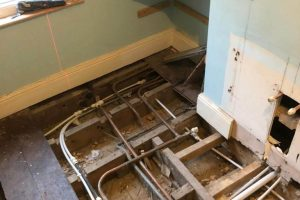 Exposing earlier pipework; bedroom used to be a bathroom
