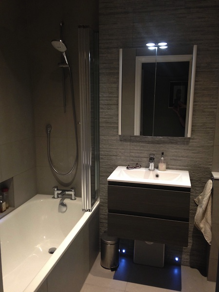 Small bathroom installation in Redland, Bristol - close up of basin and vanity unit and bath with shower